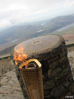 The Olympic torch and on the summit of Snowdon