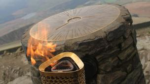 The Olympic torch on the summit of Snowdon