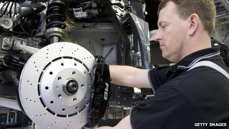 An employee of the Quattro AG, a subsidiary of Audi, works on the brakes of an Audi R8 on the assembly line in the plant at Neckarsulm, southern Germany