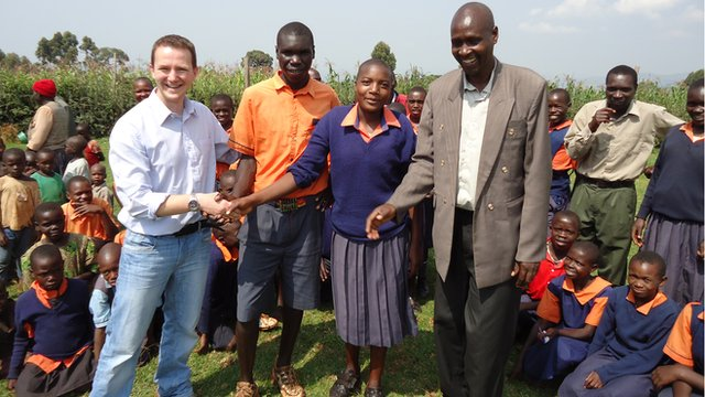 Kamuneru primary head teacher, Patrick Kibit, introduces Nick Styles to the school's head boy and girl