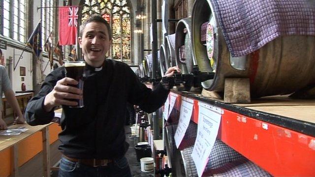 The Reverend Matt Woodcock enjoys a pint at the event