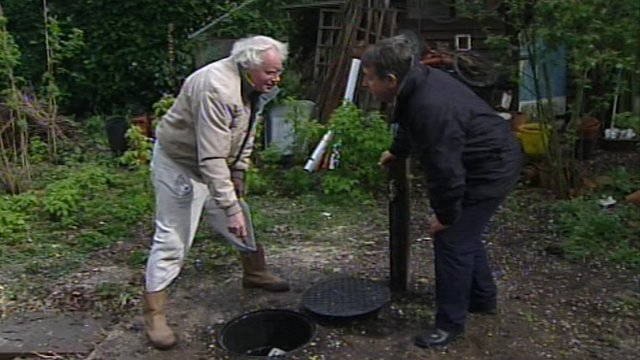 Trevor Morris and BBC South reporter Joe Campbell looking at Mr Morris's borehole