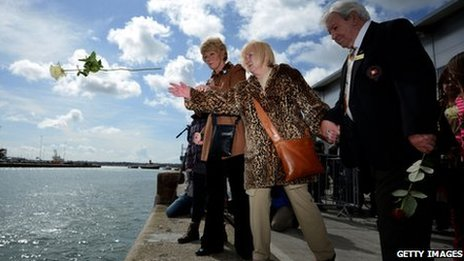 Flowers being thrown into water at Southampton Titanic service