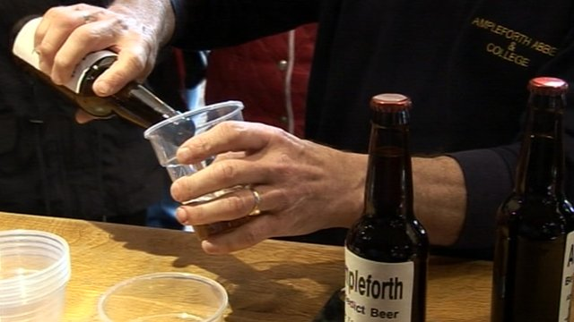 Man pouring beer into plastic pint glass