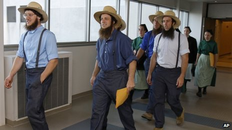 Members of the Amish community leave a courthouse in Cleveland, Ohio 19 April 2012