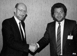 Clive Sinclair shakes hands with Alan Sugar
