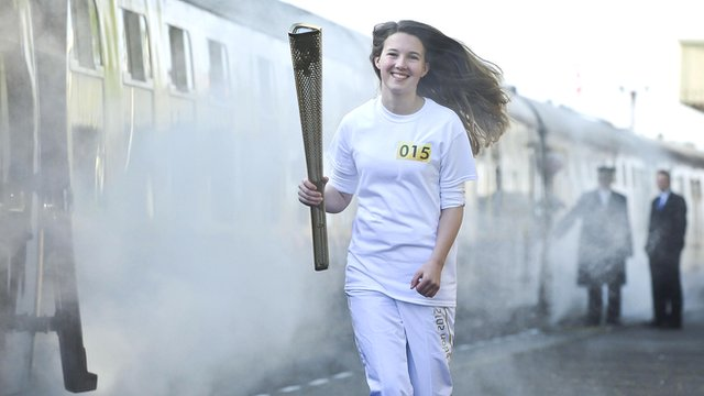 Helana Scott carries the torch during the rehearsal at the Great Central Railway station in Leicester
