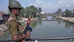 File picture of an Indian paramilitary soldier stands guard on a bridge on the Jhelum river in central Srinagar.