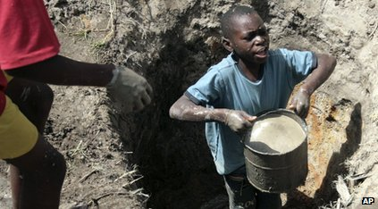 Boy looking for clean water in Zimbabwe