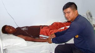 Adrian Vasquez receives medical attention aboard an Ecuadorean navy ship offshore Galapagos Islands, 25 March 2012