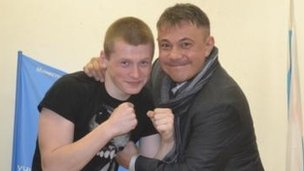 Konstantine Tszyu grapples with a student from the School of Olympic Reserve
