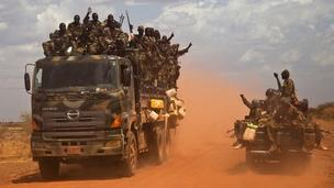 "SPLA (South Sudan People""s Liberation Army) vehicles drive on the road from Bentiu to Heglig, on April 17, 2012"