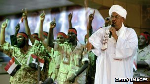 Omar Bashir addresses a youth rally in support of troops