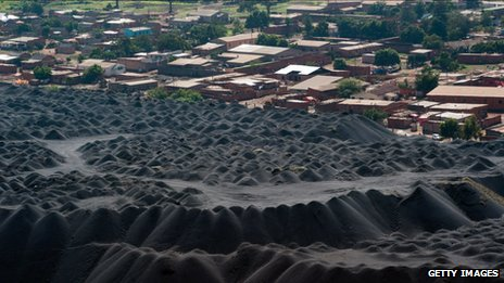 Houses originally built for factory workers sit below a slag-heap at the Gecamines concession in Lumubashi, in the heart of the mineral rich Katanga province in Democratic Republic of the Congo