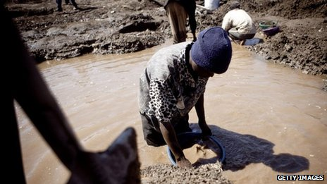 A child washes copper at an open-air mine in Kamatanda in the rich mining province of Katanga