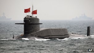 In this April 23, 2009 file photo, a Chinese Navy nuclear-powered submarine sails during an international fleet review in the waters off Qingdao, China