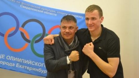 Konstantin Tszyu (left) grapples with a student from the Special School of the Olympic Reserve