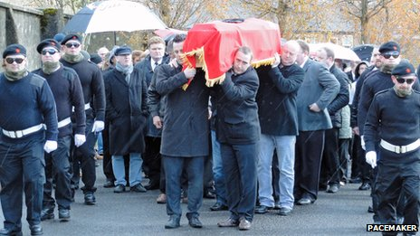 Colum Eastwood carries coffin