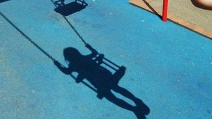 child's shadow on swing