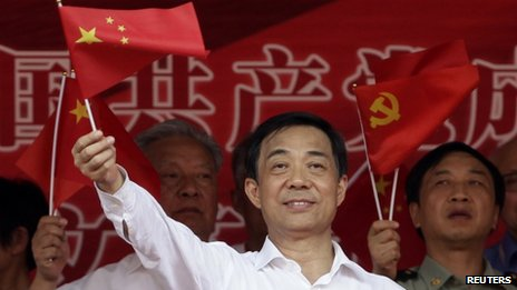 Bo Xilai waves a Chinese national flag. File photo