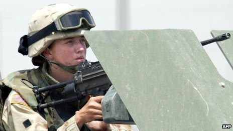 A female US soldier manning a machine gun on a vehicle during clashes in the northern Iraqi city of Mosul  13 June 2003