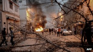 Anti-government protesters clash with riot police in a Shia suburb of Manama, 20 April 2012