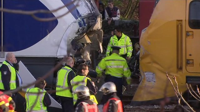 Officials inspect train crash scene
