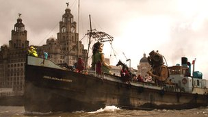 Giants on boat in the River Mersey