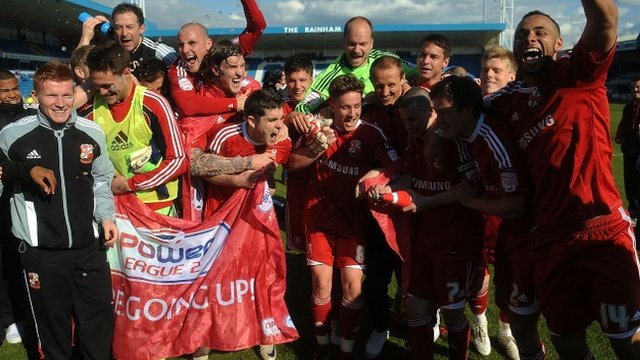 Swindon celebrate their promotion to League One.