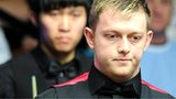 Mark Allen, with Cao Yupeng in the background