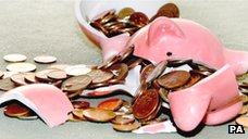 A smashed piggy bank with coins spilling out