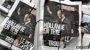 Piles of the French daily newspaper Liberation after early results in the first round vote of the 2012 French presidential election