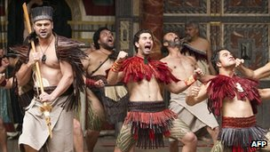 Members of New Zealand's Ngakau Toa theatre company perform a haka on stage at the Globe theatre