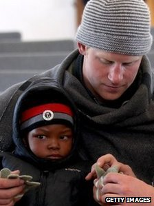 Prince Harry with a child in Lesotho