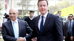 Ahmed Shafiq shaking hands with British Prime Minister, David Cameron