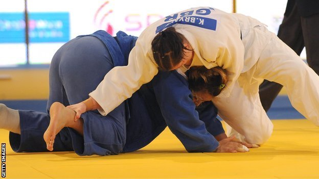 Karina Bryant (white) in action at the 2010 European Championships