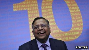Tata Consultancy Services CEO Chandrasekaran laughs while interacting with reporters after a news conference in Mumbai