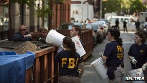 FBI officials remove rubble from the basement 20 April 2012