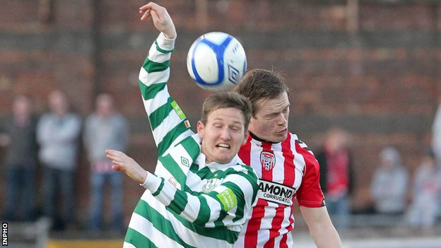 Gary Twigg battles with Derry&#039;s Simon Madden at the Brandywell