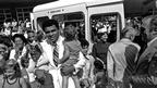 Mohammed Ali, the world heavyweight boxing champion, is seen here at the handover of a Transit bus to the Variety Club of Great Britain, 1977