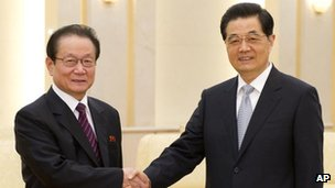 In this photo released by China's Xinhua News Agency, Chinese President Hu Jintao, right, greets North Korean envoy Kim Yong Il, head of the international department of the Workers' Party of Korea, during their meeting in Beijing on 23 April, 2012