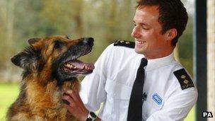 Alsatian cross Soldier with RSPCA inspector Patrick Bailey