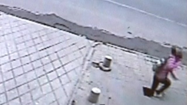 Girl falling through pavement