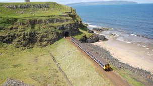 Heyday: the train runs along the coast at Castlerock  Pic: Chris Playfair