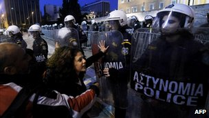 Protesters and police in Athens