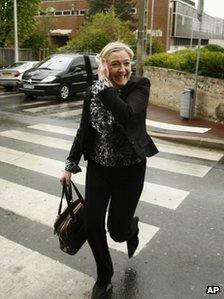 Marine Le Pen crosses a road in Nanterre, near Paris, 23 April 2012
