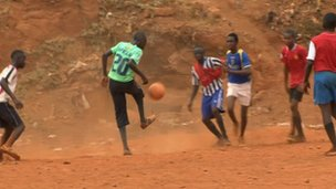 Boys playing football on the patch of land that once housed the amputee camp in Freetown, April 2012