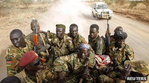 South Sudan&#039;s army, or the SPLA, soldiers drive in a truck on the front line in Panakuach, Unity state