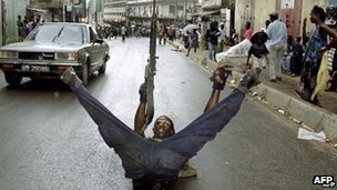 A file photo taken on 31 May 1997 shows a Sierra Leonean soldier of the Revolutionary United Front (RUF) posing in a street of Freetown