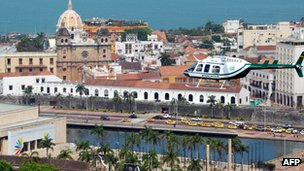 A helicopter flies over Cartagena during preparations for the Summit of the Americas on 12 April 